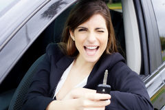 Cute woman with new car looking camera smiling happy Royalty Free Stock Photos