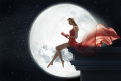 Cute woman over full moon background. Cute lady over full moon background stock image