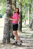 Cute woman in the park Royalty Free Stock Image
