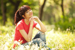 Cute woman in the park Royalty Free Stock Images
