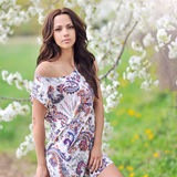 Cute woman in the park in summer Stock Photos