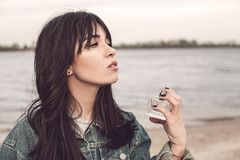 Woman with perfume bottle. Cute woman with perfume bottle Royalty Free Stock Images