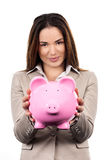 Cute woman with piggy bank Stock Photos