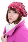 Cute woman in pink coat Stock Images