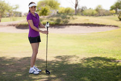Cute woman playing golf Stock Photography