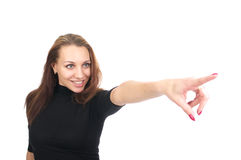 Cute woman pointing. Portrait of cute cheerful woman pointing, isolated over white background Royalty Free Stock Photo