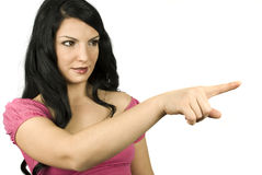 Cute woman pointing Royalty Free Stock Images