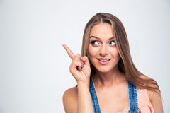 Cute woman pointing finger away. Happy cute woman pointing finger away isolated on a white background Stock Image