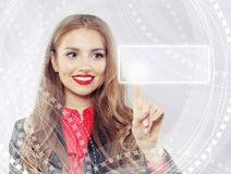 Cute woman pointing to empty address bar in virtual web browser.  royalty free stock image