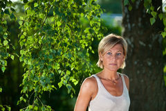 Cute woman portrait with tree branches Stock Photos
