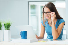 Cute woman posing with glasses Royalty Free Stock Photos