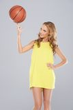 Cute woman posing and spin basket ball Stock Photo