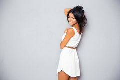 Cute woman posing in trendy white dress Royalty Free Stock Image