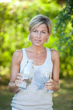 Cute woman pouring water in a glass Royalty Free Stock Photography