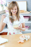 Cute woman preparing a meal in the kitchen Stock Photos