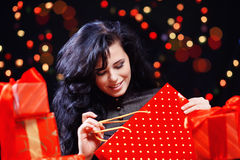 Cute woman with presents at night Royalty Free Stock Images