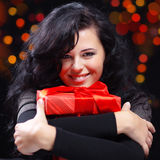 Cute woman with presents at night Stock Photos