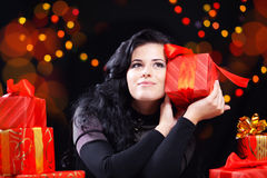 Cute woman with presents at night Royalty Free Stock Photo