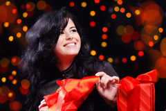 Cute woman with presents at night Royalty Free Stock Image