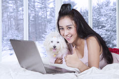 Cute woman with puppy showing thumb up Royalty Free Stock Photography