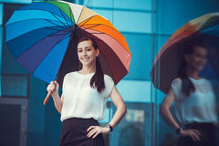 Cute woman with rainbow umbrella Stock Images
