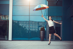 Cute woman with rainbow umbrella Stock Photos