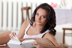 Cute woman read book in morning interior Stock Image