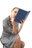 Cute woman reading a book Stock Images