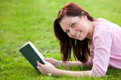 Cute woman reading a book Royalty Free Stock Photography