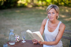 Cute woman reading a book Royalty Free Stock Images
