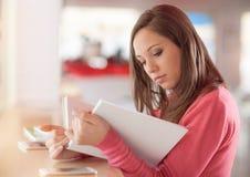 Cute woman reading a book Stock Photos