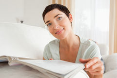 Cute woman reading a magazine Royalty Free Stock Image