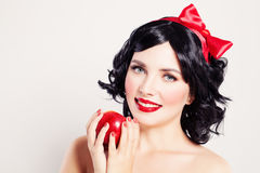 Cute Woman with Red Apple Stock Image