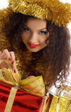 Cute woman with red christmas gift Stock Photo