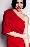 Cute woman with red lips and red dress Royalty Free Stock Photos