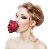 Cute woman with red rose in mouth Stock Photos