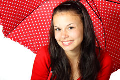 Cute woman with red umbrella. Young woman with red dotted umbrella smiling Stock Image