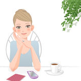 Cute woman relaxing at café with smart phone Stock Images