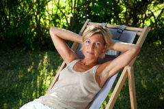 Cute woman relaxing Royalty Free Stock Photos