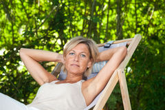 Cute woman relaxing Royalty Free Stock Images