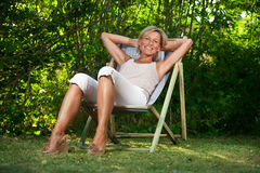 Cute woman relaxing Royalty Free Stock Photography