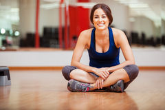 Cute woman relaxing at a gym Stock Photography