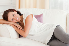 Cute woman relaxing on her sofa Stock Photos
