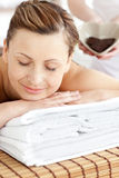 Cute woman relaxing on a massage table Stock Images