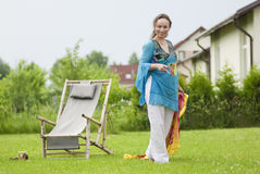 Cute woman relaxing on nature Royalty Free Stock Image