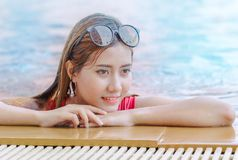 Woman relaxing by the pool side Royalty Free Stock Photos