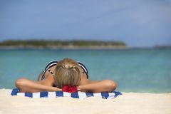 Cute woman relaxing on the tropical beach.  Royalty Free Stock Photos