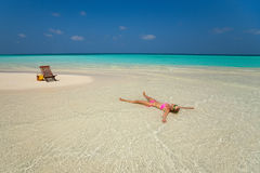 Cute woman relaxing on the tropical beach Royalty Free Stock Photography