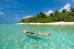 Cute woman relaxing on the tropical beach Royalty Free Stock Images