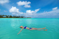 Cute woman relaxing on the tropical beach Royalty Free Stock Image